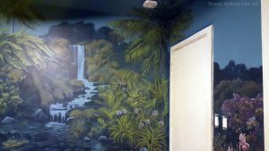 Enchanted Forest Mural: A palm painted over three surfaces to soften the corner